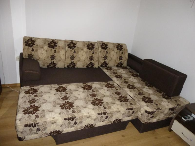 Spread corner sofa bed for two people.