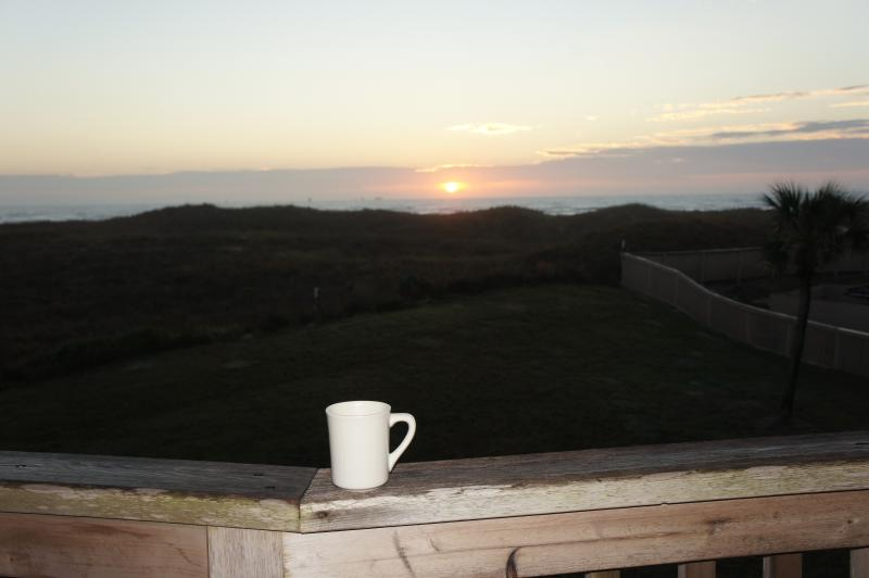 Drink your morning coffee and watch the sunrise over the ocean!