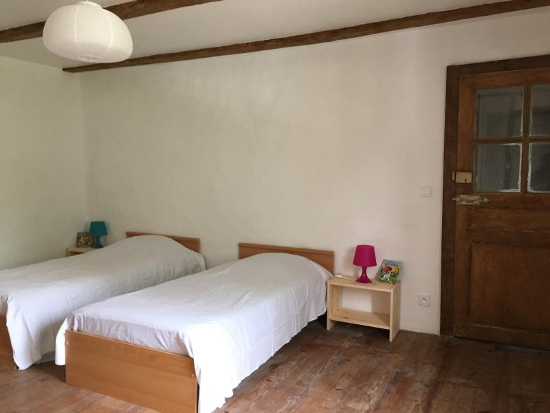 other bedroom with 3 single beds