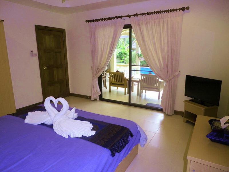 Attractive Master Bedroom Overlooking the Pool