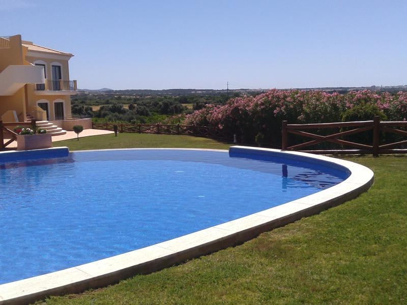 Closed Condominium with beautiful garden and great swimming pool