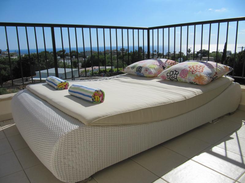 Relax in comfort out on the very spacious sun terrace with sea and mountain views