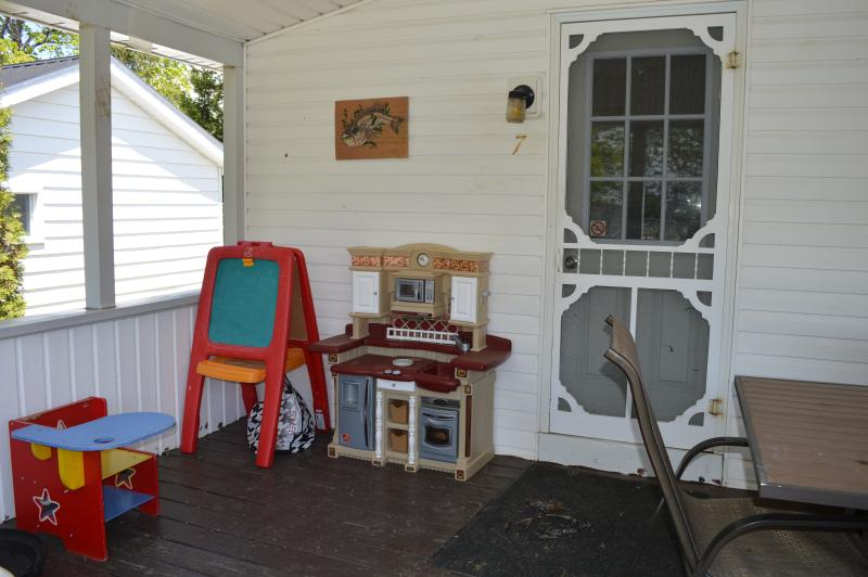 Cottage 7 - 2 bedrooms - 1 queen, other with bunk beds and single sleeps 5. Covered deck faces pool