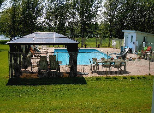 20X40 in-ground pool area, screened gazebo, kids slide, lounge chairs