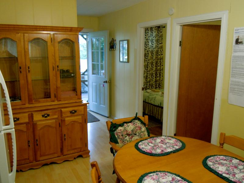 Cottage 8 - Two bedrooms with queen size beds, kitchenette/eating area, covered deck faces pool