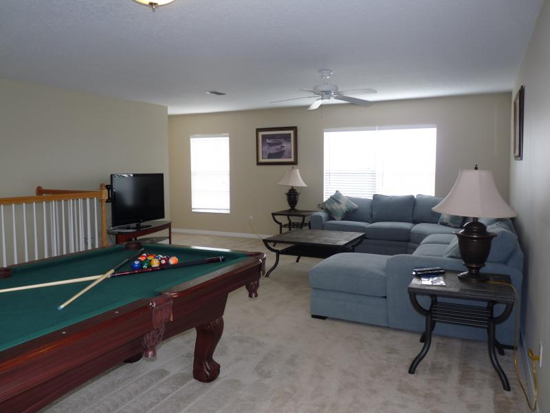 View of upstair living/play room showing pool table and sofa