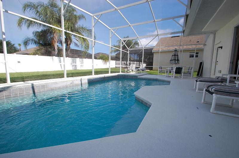 Beautiful blue sparkling pool which is not overlooked by rear neighbours