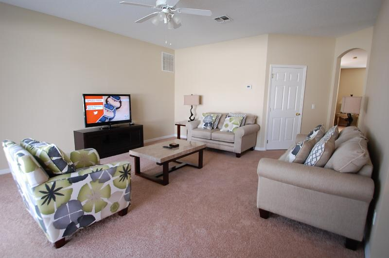 Fresh Family living room which is fitted with a 3&2 seater sofa and accent chair, large flat screen