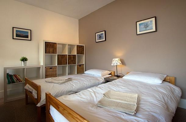 Beds in our spacious rooms can be singles or doubles. Tell us when you book.