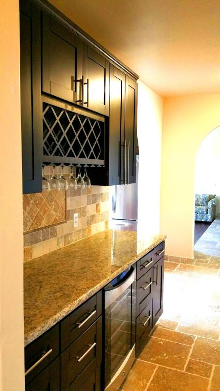 Wine rack and wine cooler next to kitchen