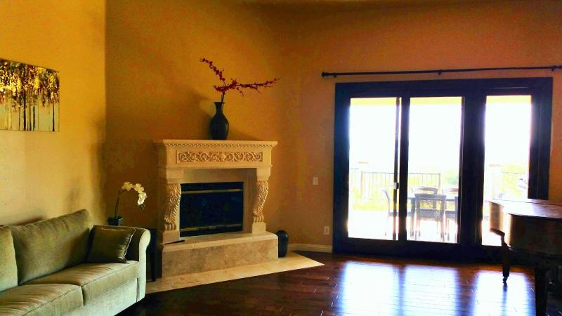 Living room with cast stone fireplace
