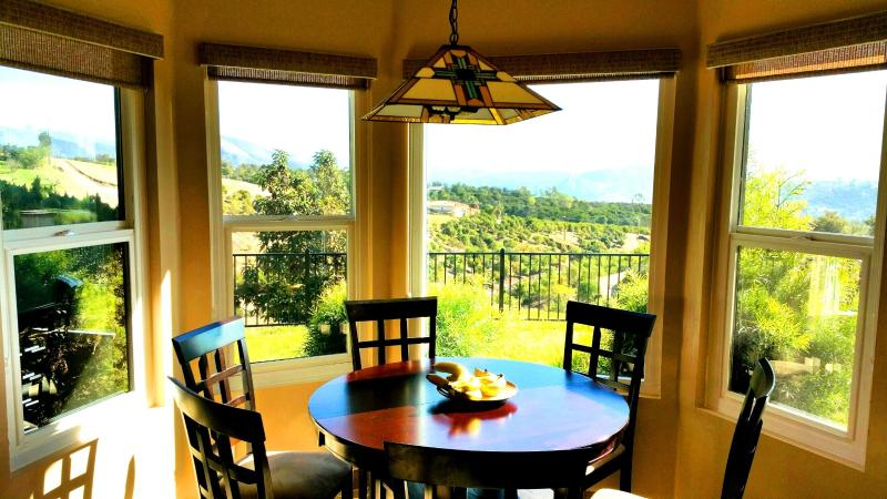 Casual dinning area next to kitchen with picture perfect mountain view