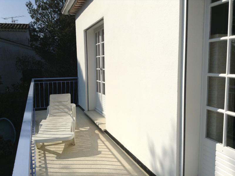 The balcony, side yellow room