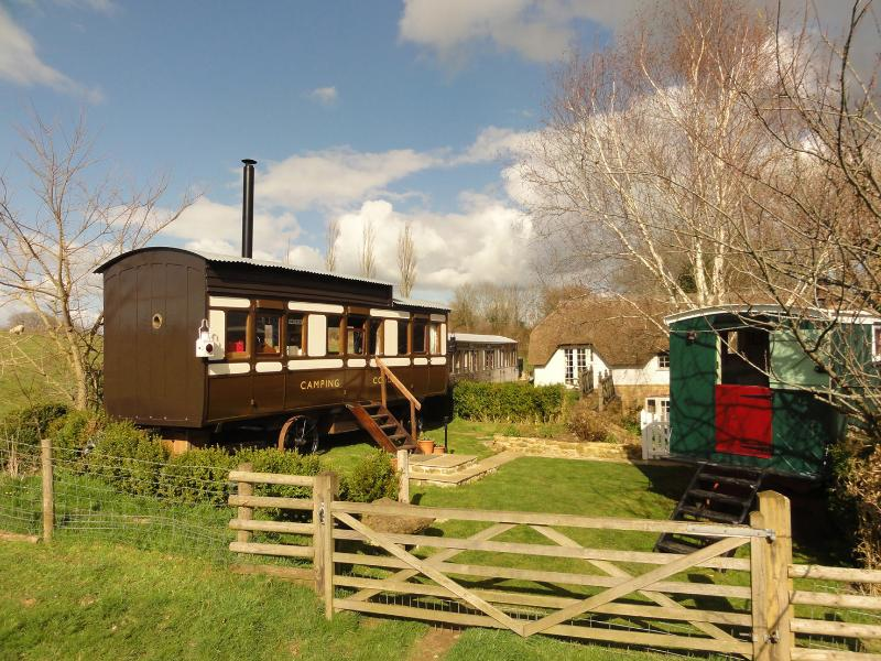 High Cross Camping coach and Living van are situated at the corner of the cottage garden