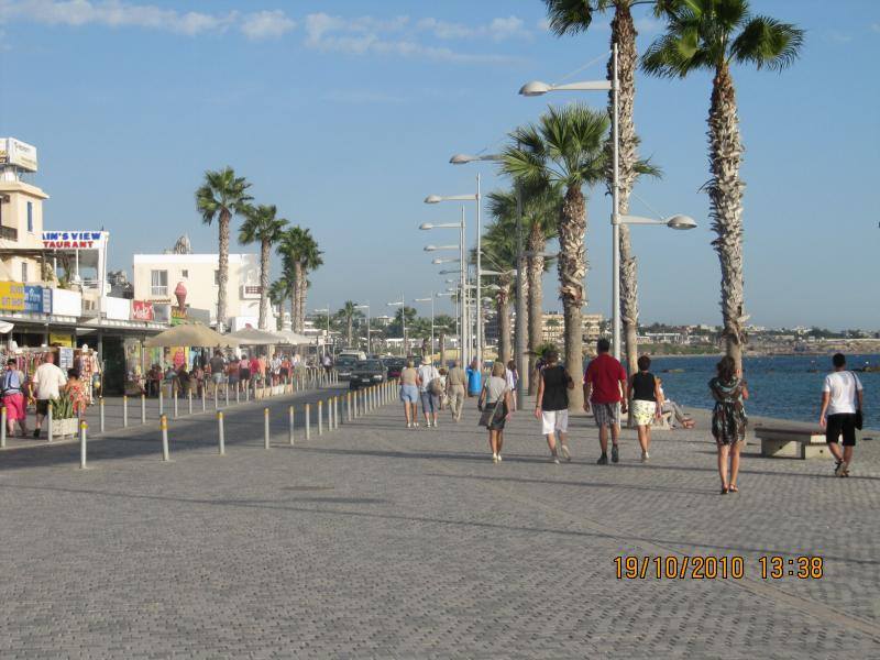 Paphos Harbour main strip lined with restaurants, shops, bars