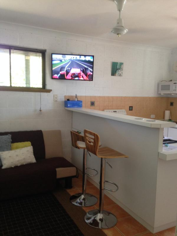 3 seater futon, converts to double bed. Breakfast bar / eating. Wall mounted large flat screen telev