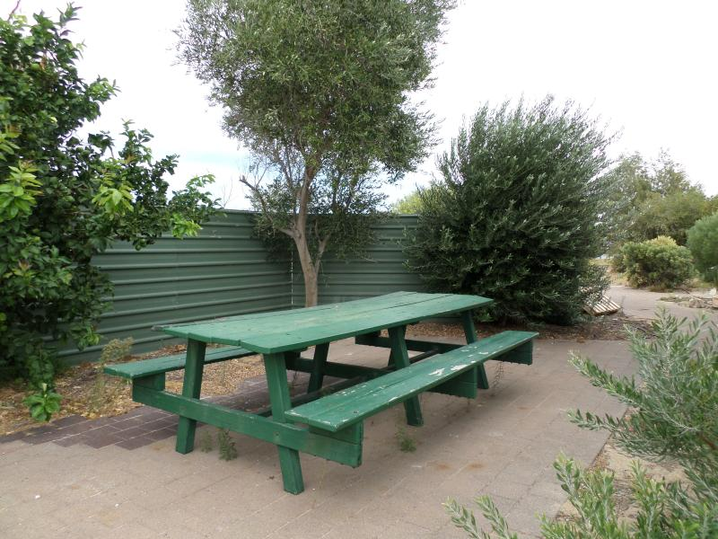 Community picnic area along side the apartment. There is also a play ground. Barbeques nearby