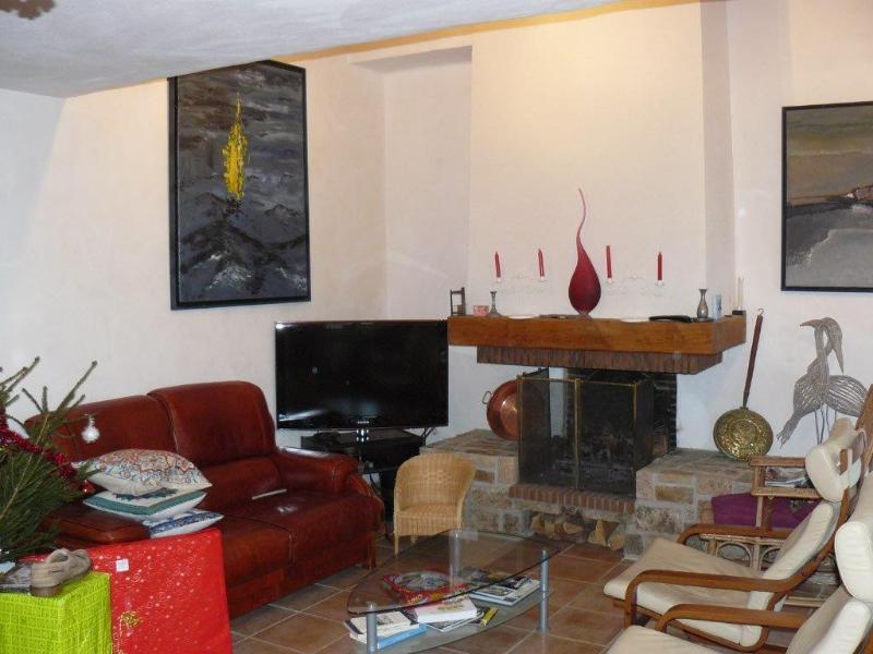De woonkamer; kant lounge, met zijn banken in leer en de lege op verblijf