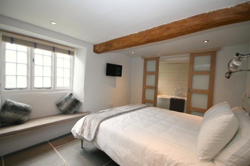 king size bed and ensuite with underfloor heating