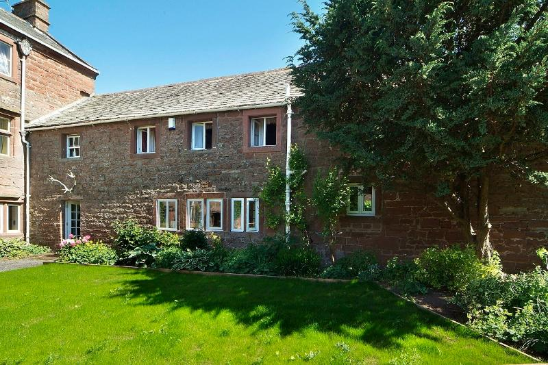Stag Cottage; three ensuite bedrooms, private front and gated rear gardens, open fire and terrace.