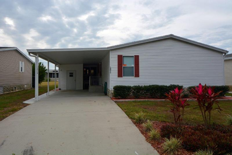 Front of house with carport