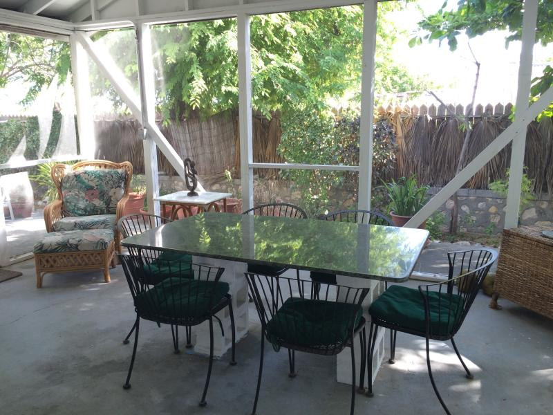 Enjoy the islands beautiful breezes while dining or relaxing in Seasongs screened in porch