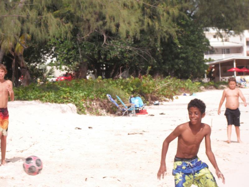 Boys playing on Rockley beach