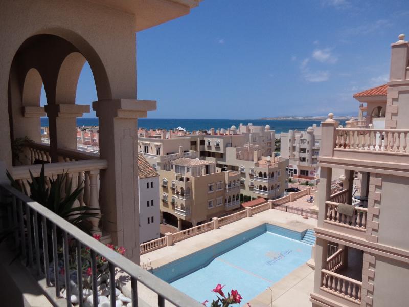 Verandah runs from lounge to main bedroom overlooking coastline and swimming pool.