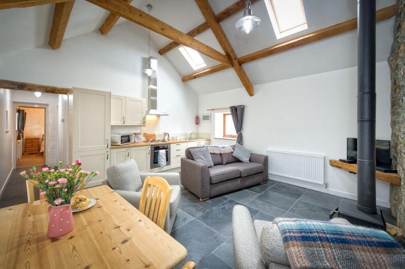 Recently renovated open plan Kitchen, Lounge and diner. Fridge/freezer, Log burner,TV, DVD, Freesat,