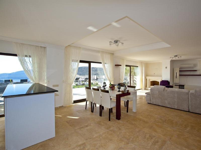 O plano aberto espaçoso salão/cozinha/jantar