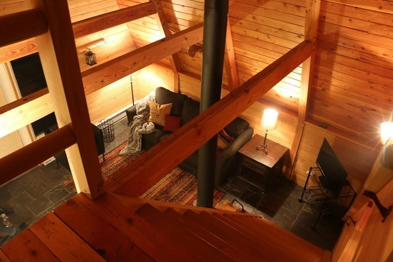 View from loft stairs to living area