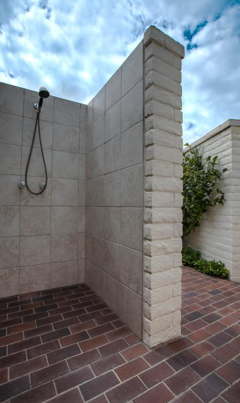 Private outdoor shower with direct access to house for easy way to clean off beach sand