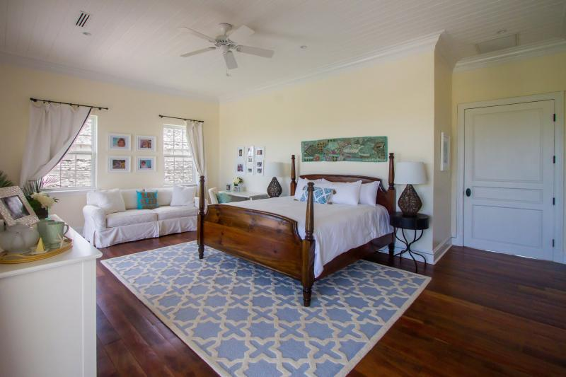 The soft blues of the Master Bedroom are reminiscent of the idyllic bahamian seas