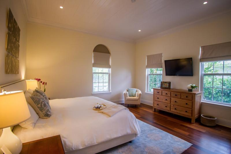 The warm, downstairs, king-bedded guest bedroom.