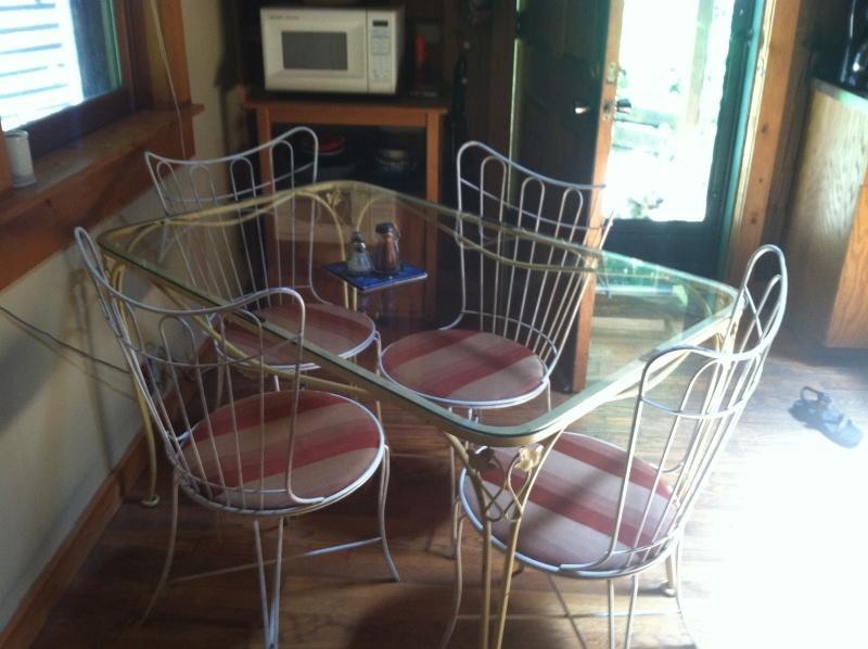 Vintage glass top dining table for 4