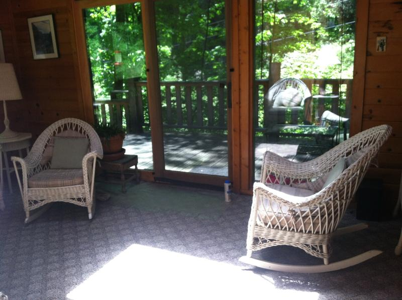 another of sunroom with access to deck with hot tub & creek