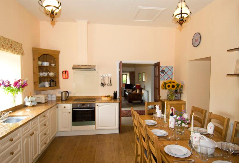 Spacious Barn kitchen with granite worktops ... and spectacular views across the wooded valley