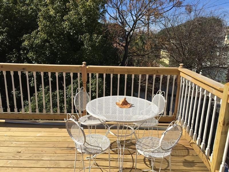 Private deck (so close to beach you can hear the ocean!) with brand new grill