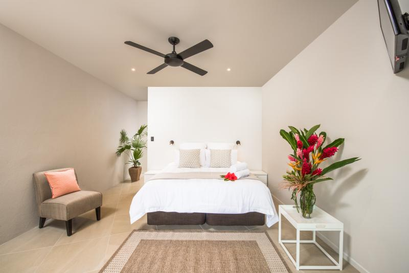 Large air-conditioned bedrooms with view to pool.
