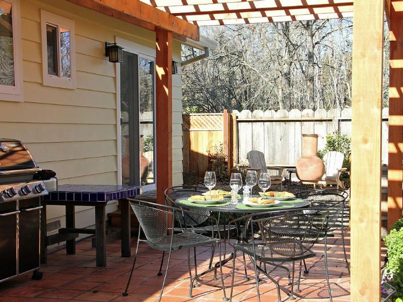 Outdoor BBQ kitchen with dining patio.