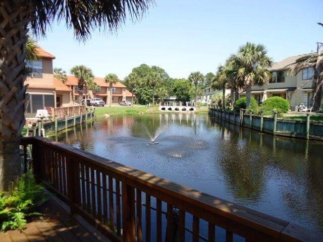 Beautiful canal view from your back door! Beautiful lagoon pool just steps from your front door!