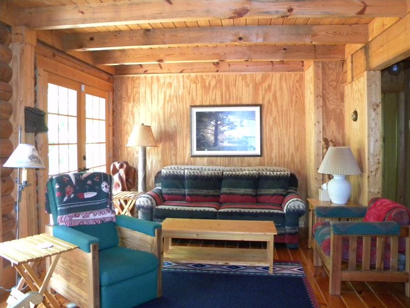 Your home away from home awaits with cozy furnishings and lovely lake views