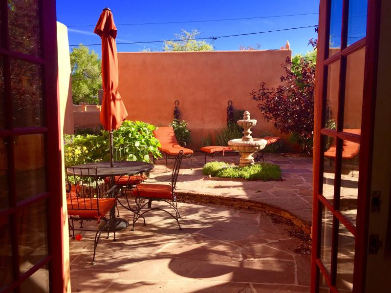 Kitchen open to Beautiful Courtyard: Outdoor Dining, Chaises, Infrared BBQ, Fountain
