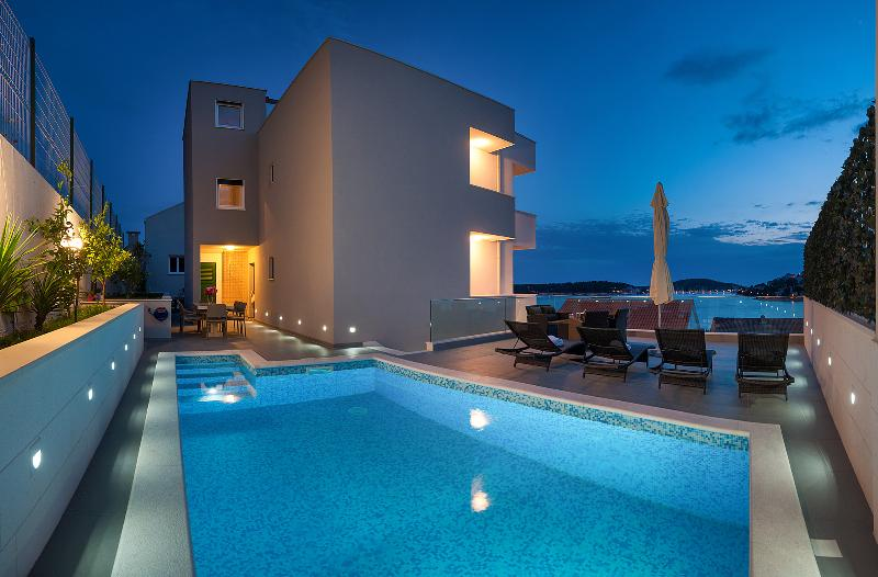 villa with the pool area in the night