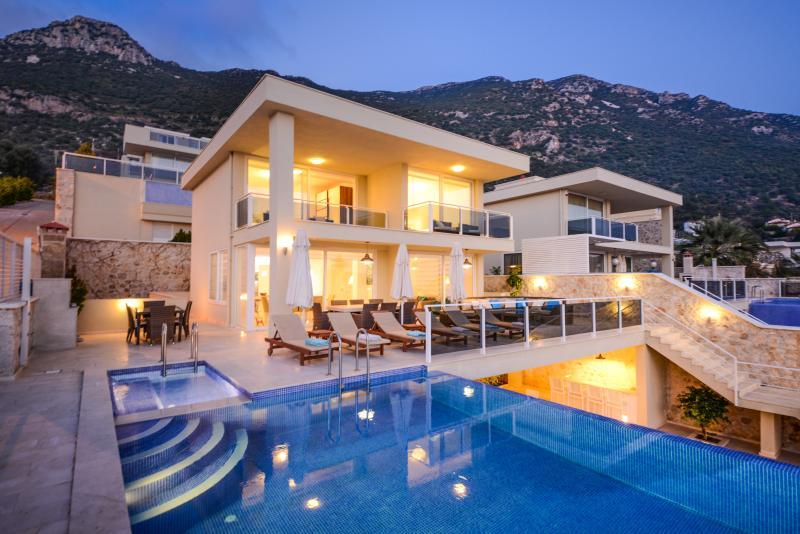Villa set into the hillside, mountain back drop