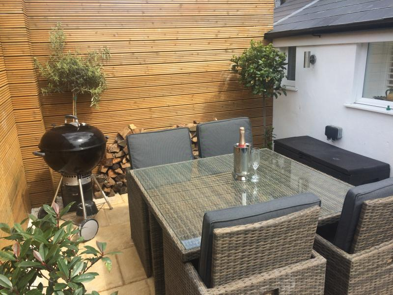 Secluded South-West facing patio garden with luxury garden furniture and BBQ