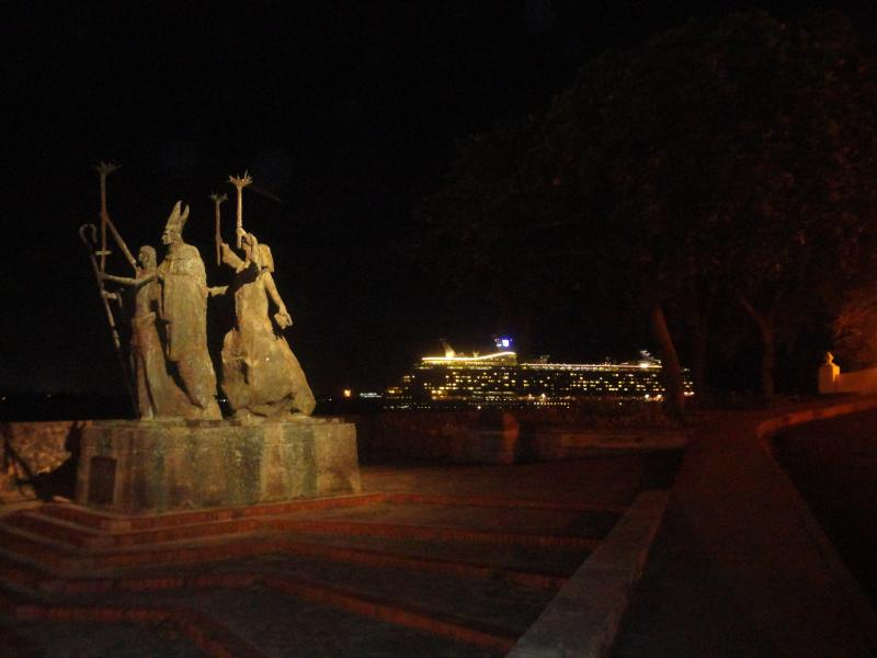 Night view from steps of apart with passing cruise ship inbackground