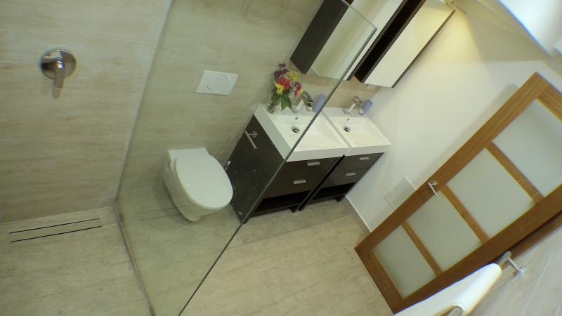 Bathroom with double sink, hot water and walk-in power shower