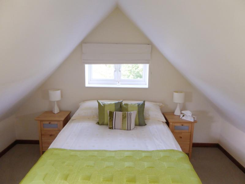 The cosy king-size bedroom sits on the first floor, boasting views of the surrounding countryside.