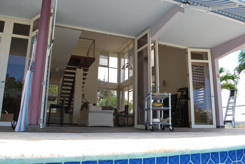 view from pool into living room and kitchen at left